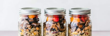 three full clear glass jars with lids